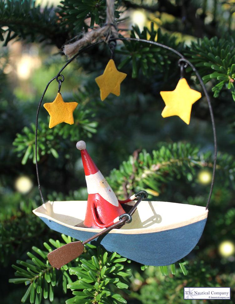 nautical christmas decorations - santa in canoe - the nautical company